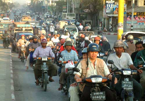 Motorbikes crowd the streets of Mandalay. Photo: Staff