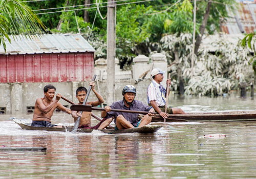 People commute in Kalay. The ongoing floods are expected to have a significant impact on the economy. Photo: Aung Myin Ye Zaw / The Myanmar Times