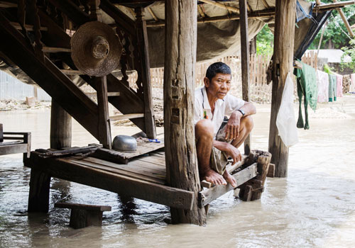 Floodwaters inundate the property of a resident of Minn Zan village in Pwint Phyu township, Sagaing Region, on August 4. Photo: Aung Khant / The Myanmar Times