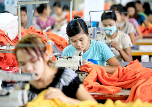 Myanmar labourers work at a garment factory in Hlaing Tharyar township on the outskirts of Yangon in July. Photo: EPA