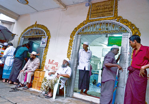 Men rest outside the Nasarpuri Mosque in Yangon's Pabedan township. (Aung Htay Hlaing/The Myanmar Times)