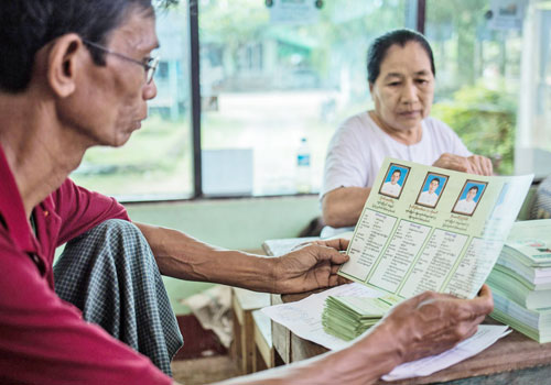 USDP campaign pamphlets are folded in Mawlamyine. (Zarni Phyo/The Myanmar Times)