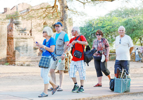 Tourists gape in awe at the wonders of Bagan in August. Photo: Si Thu Lwin / The Myanmar Times