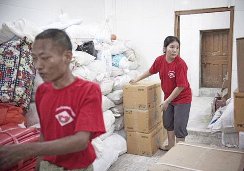 Noble Heart rescue ambulance charity service Volunteers sort out flood relief supplies at their headquarters in Yangon.