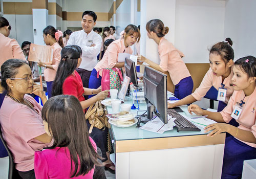 Customers wait at the counter of one of Yangon's modern microfinance institutions.Photo:Thiri Lu / The Myanmar Times