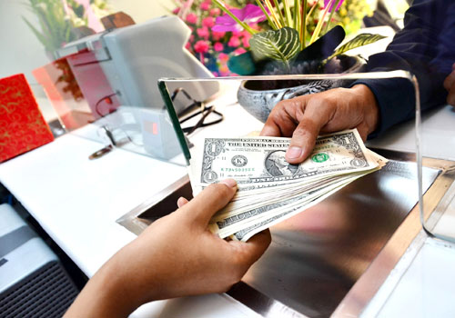 Foreign exchange licences held by businesses including airlines, hotels and shops have been recalled by the Central Bank of Myanmar. Photo: Aung Htay Hlaing / The Myanmar Times