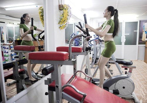 Student May Nandar Kyaw works out in her private gym at her house in Yangon.