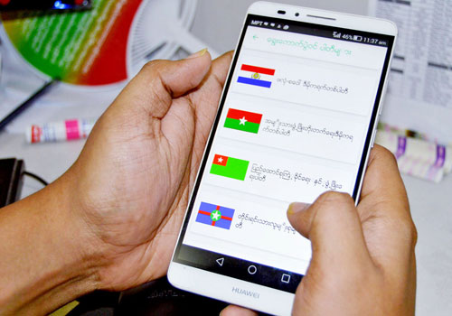 A mobile user uses the Tha Din app.(Aung Kyaw Nyunt/The Myanmar Times)