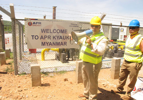 A man leads a tour of APR's Kyaukse plant in 2014.(Aung Shin/The Myanmar Times)