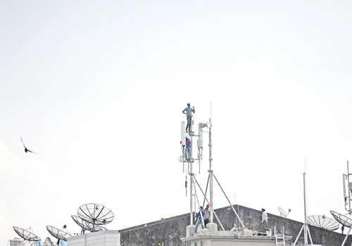 Telecoms towers dot the skyline of downtown Yangon. Photo: Staff