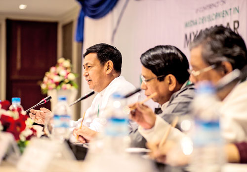 U Ye Htut (left) speaks during the New Dynamics in Myanmar Media press conference at Chatrium Hotel in Yangon on December 10. Photo: AFP
