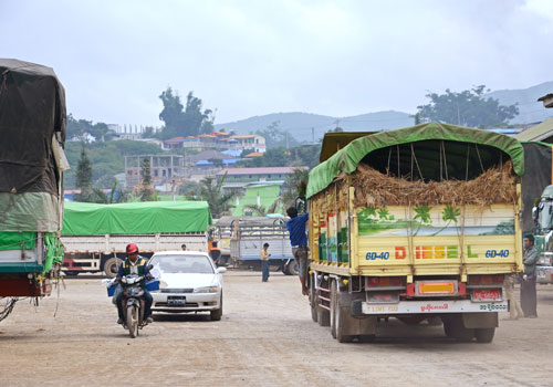 A truck filled with straw drives through Muse in Shan State, Myanmar's biggest trading point with China. Photo: Aung Htay Hlaing / The Myanmar Times