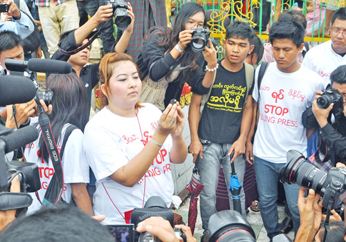 Ma Shwe Hmone (centre) takes part in a protest in Yangon last year. (Wa Lone/The Myanmar Times)