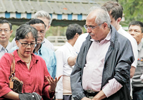 Vijay Nambiar, the UN secretary-general's special adviser on Myanmar (right), visits Muslim migrants staying at a temporary centre in northern Rakhine State on May 23 before being repatriated to Bangladesh. Photo: EPA