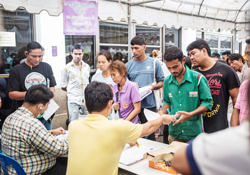Migrants queue to renew pink cards in Mae Sot, Thailand, in late June. (Zarni Phyo/The Myanmar Times)