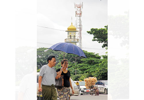 Cell phone towers are springing up in Yangon as the telcos spread coverage. Photo: Yu Yu / The Myanmar Times