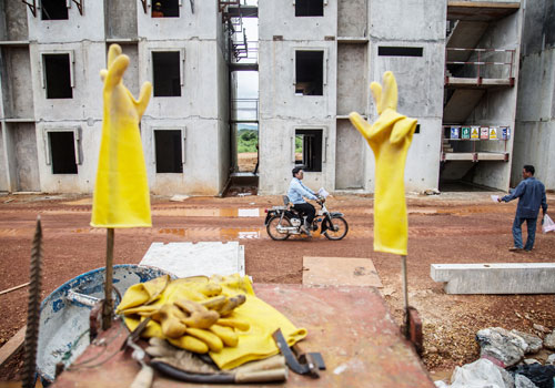 A worker rides a motorbike at the Dawei special economic zone construction site. Photo: Aung Myin Ye Zaw / The Myanmar Times