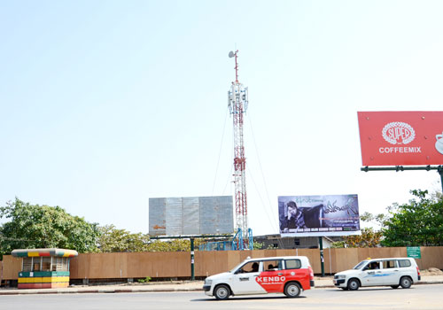 Cars drive past a telecoms tower in Yangon.( Aung Htay Hlaing/The Myanmar Times)
