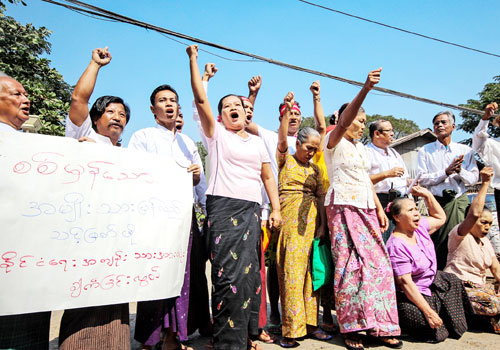 Newly released land activists protest at Insein prison for the release of all political prisoners. Photo: Naing Wynn Htoon / The Myanmar Times