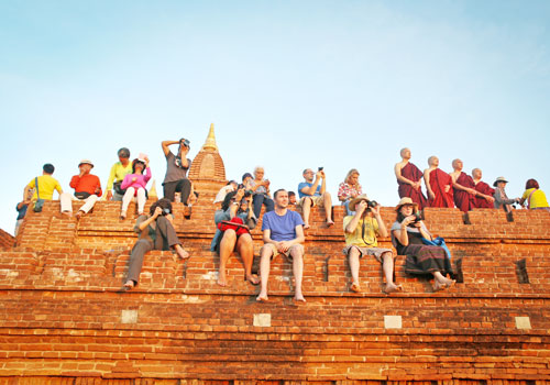 Tourists try to catch the perfect shot of sunset over the temples of Bagan. Photo: Yu Yu / The Myanmar Times