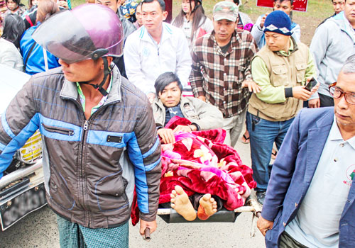 An injured member of anti-narcotic campaign group Pat Ja San arrives at hospital in Myitkyina, Kachin State, yesterday after clashes with an armed group during a poppy eradication mission. Photo: EPA