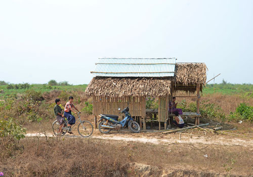 Residents ride a bicycle on the Sukalat rubber plantation. Photo: Aung Htay Hlaing / The Myanmar Times