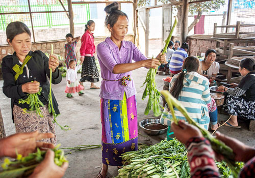 Women displaced by recent conflict in northern Shan State prepare lunch at the Kanbawza Shan Kyaung Kyee monastery in Kyaukme on February 17. Photo: Kaung Htet / The Myanmar Times