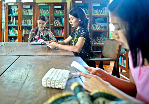Young women participate in the Tech Age Girls program at a library in Insein township, Yangon. Photos: Thiri Lu / The Myanmar Times