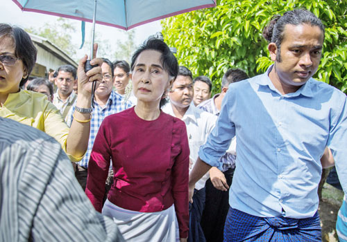 Daw Aung San Suu Kyi arrives at a polling station on election day, November 8, 2015. Photo: Aung Myin Ye Zaw / The Myanmar Times