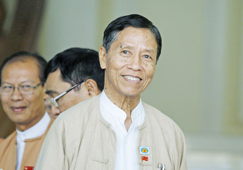 Finance Minister U Kyaw Win leaves parliament in March. Photo: EPA