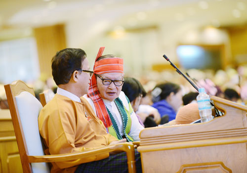 Members of the 2016-21 class of parliament chat during a legislative session in the hluttaw chamber in Nay Pyi Taw. Photo: Aung Htay Hlaing / The Myanmar Times