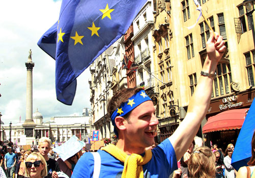 "A man waves an EU flag during the ""March for Europe"" rally in London on July 2. Photo: EPA"