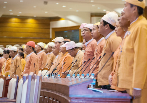 MPs stand while Speaker U Win Myint enters the Pyithu Hluttaw on March 11. Photo: Aung Khant / The Myanmar Times