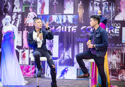 Kukso Koo (left) speaks to students at his Haute Couture Design and Draping workshop in Yangon. Photo: Nyan Zay Htet / The Myanmar Times