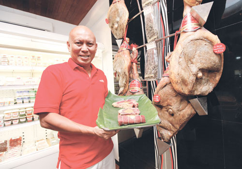 Sharky's owner U Ye Htut Win displays cuts of steak at his restaurant and delicatessen on Dhammazedi Road in Yangon. Photo: Staff