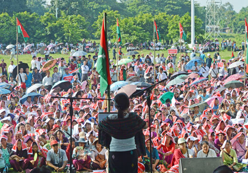 A woman speaks to yesterday's gathering in Myitkyina in support of an end to fighting in Kachin and Shan states. Photo: Supplied