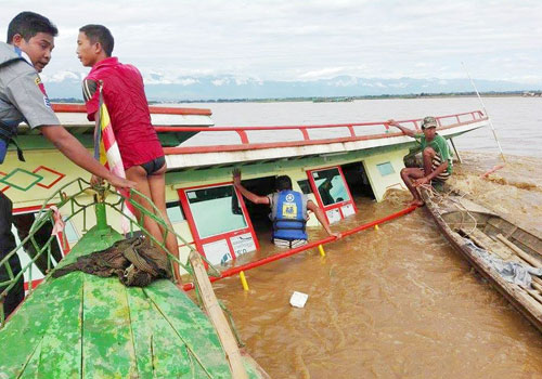 The Lin Lin Aung cargo ferry is seen as it sinks into the Chindwin River. Photo: Supplied / U Aww Thahta