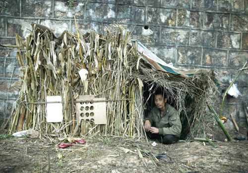 A refugee from Myanmar rests in a temporary shelter in Wanding, in China's Yunnan province, yesterday. Photo: AFP