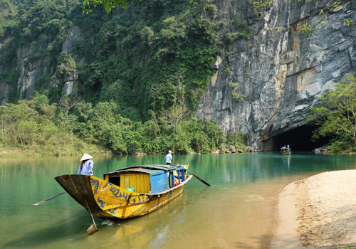 Tourists explore a cave in Phong Nha national park.