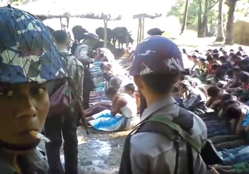 A still from the video, posted to social media on December 31, which appears to record police officers beating detained villagers in Rakhine State. Photo: Supplied