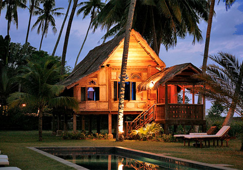 Bungalows nestled into the jungle provide a lush getaway from city centres. Photo - Shutterstock