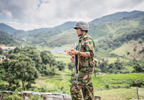 A soldier patrols the hills near Mai Ja Yang, Kachin Independence Army-controlled territory in Kachin State, during a conference of ethnic armed groups in July 2016. Photo: Zarni Phyo / The Myanmar Times