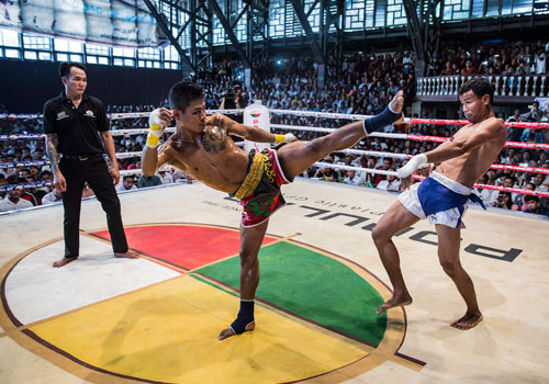 Youkthit (right) proved no match for Myanmar's Htun Naing Oo, who dominated his muay thai opponent with a flurry of punches.