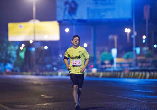 A runner separates from the pack in the early hours of the race. Photo: AFP
