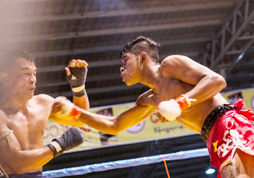 Htun Lwin Moe (right) knocks out Laos' Hnun Lan Lax just two minutes into the second round of their fight. He was one of four Myanmar champions to knock out their muay thai-trained opponents.