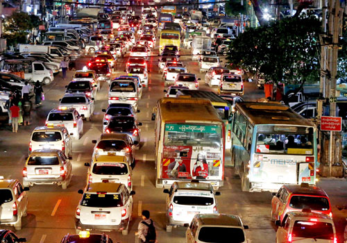 Traffic flows in downtown Yangon. Photo: EPA