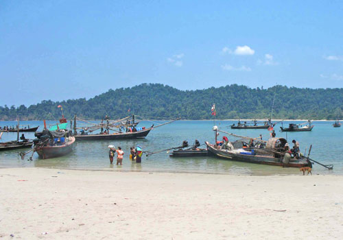 Fishing boats line Myeik's Bo Cho Island with Lampi Island visible in the background. Photo: Supplied