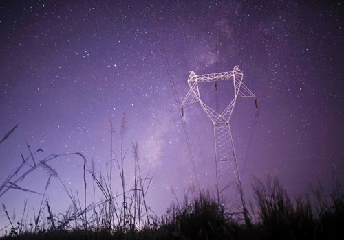 This long-exposure picture taken on October 28, 2016 shows parts of the Milky Way in the clear night sky behind an electricity pillar near the Yangon-Nay Pyi Taw highway. Photo: AFP