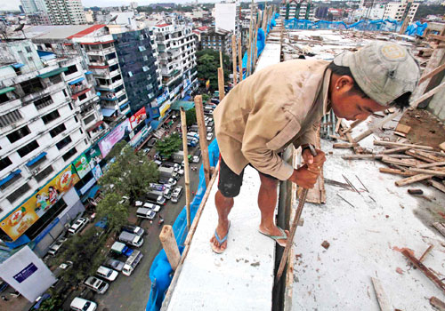 Booming property prices have pushed up the rent in Yangon. Photo: EPA