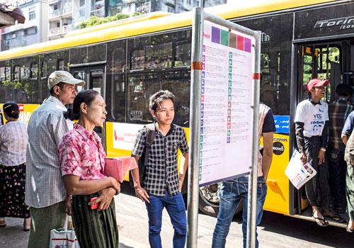 Passengers look for directions in downtown area in Yangon on January 16, the first day of the change over to the Yangon Bus Service. Nearly three months after, many bus drivers and conductors are still not following the stipulated rules and regulations because action was not taken against them. Zarni Phyo / The Myanmar Times